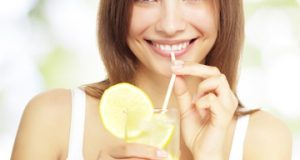 woman-drinking-water-with-lemon-vert_m1ai1o